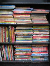 THREE SHELVES CONTAINING LARGE QUANTITY OF CHILDREN'S ANNUALS INCLUDING RUPERT, THUNDERBIRDS, JOE 90, ETC.