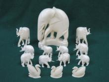 PARCEL OF CARVED IVORY ELEPHANTS AND SWANS