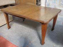 ANTIQUE OAK WIND OUT DINING TABLE WITH ONE LEAF.