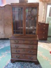 ANTIQUE MAHOGANY CHEST OF FOUR DRAWERS WITH GLAZED BOOKCASE ON TOP