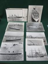 COLLECTION OF SHIPPING RELATED BLACK AND WHITE COMMERCIAL PHOTOGRAPHS, VARIOUS OCEAN LINERS AND MILITARY SHIPS. APPROX 20