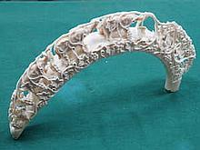 HEAVILY CARVED ANTIQUE IVORY PIERCEWORK DECORATED ELEPHANT BRIDGE (AT FAULT)