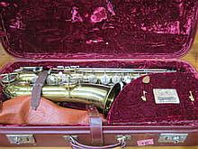 CASED BUESCHER TRUE TONE AMERICAN BRASS C MELODY SAXOPHONE BY ELKHART, NUMBERED 165396