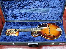 CASED IBANEZ INLAID AND MOTHER OF PEARL DECORATED MANDOLIN, NUMBERED 1768048