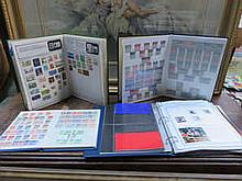 FOUR STAMP ALBUMS CONTAINING BRITISH AND FOREIGN POSTAGE STAMPS