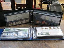 TWO SMALL ALBUMS CONTAINING VARIOUS FIRST DAY COVERS