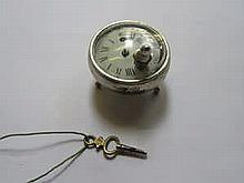 POCKET WATCH DIAL/MOVEMENT INSIDE AN INTERESTING CONTINENTAL SILVER COLOURED STAND ON THREE RAISED FEET