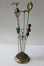 HALLMARKED SILVER HAT PIN STAND AND SIX VARIOUS HAT PINS INCLUDING ONE BY CHARLES HORNER