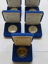 FOUR CASED LIMITED EDITION SILVER PROOF 'BISHOP A.T MUZOREWA' MEDALLIONS AND CASED LIMITED EDITION SILVER GILT PROOF 'PEACE' MEDALLION
