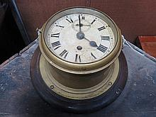 WALL MOUNTING BRASS SHIP'S CLOCK WITH ENAMELLED DIAL (AT FAULT)
