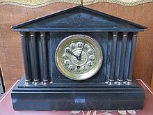 DECORATIVE BLACK SLATE COLUMN FORM MANTEL CLOCK WITH GILT METAL DIAL