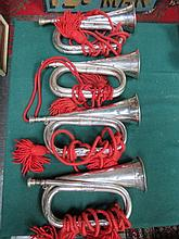 FOUR VARIOUS SILVER PLATED BUGLES