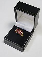 9ct GOLD LADIES DRESS RING SET WITH RUBY COLOURED STONES