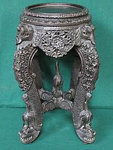 HEAVILY CARVED AND EBONISED ORIENTAL STYLE PLANT STAND WITH PIERCE WORK DEC