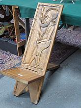 HEAVILY CARVED AFRICAN TWO PIECE CHIEF CHAIR DECORATED WITH A TRIBAL GENT