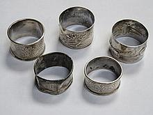 FIVE VARIOUS SILVER NAPKIN RINGS