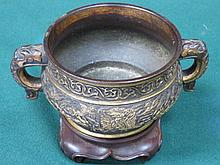 GILDED BRONZE EFFECT ORIENTAL TWO HANDLED POT ON STAND