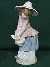 NAO GLAZED CERAMIC FIGURE- GIRL WITH HAT, APPROXIMATELY 24cm HIGH
