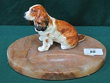 MARBLE EFFECT DESK STAND WITH MOUNTED CERAMIC DOG
