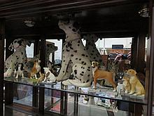 COLLECTION OF VARIOUS UNGLAZED CERAMIC DOGS