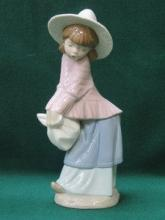 NAO GLAZED CERAMIC FIGURE- GIRL WITH HAT, APPROXIM