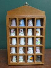 PARCEL OF TWENTY THIMBLES ON STAND INCLUDING WEDGW