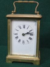 BRASS AND GLASS CARRIAGE CLOCK (AT FAULT)