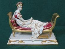 CONTINENTAL STYLE HANDPAINTED AND GILDED FIGURE OF