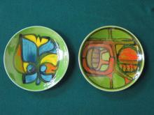 TWO POOLE GLAZED CERAMIC CIRCULAR PLAQUES, DIAMETE