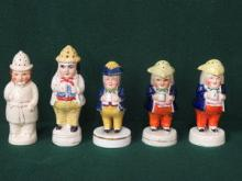 FOUR STAFFORDSHIRE HANDPAINTED FIGURE FORM PEPPER