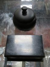 TWO SMALL EBONISED STORAGE POTS