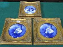 THREE GILT FRAMED BLUE AND WHITE CERAMIC PANELS DE