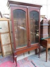 TWO DOOR GLAZED BOOKCASE ON RAISED SUPPORT