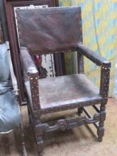 EARLY LEATHER UPHOLSTERED ARMCHAIR
