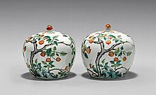 PAIR ENAMELED PORCELAIN COVERED JARS