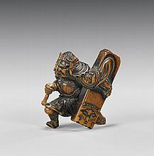 ANTIQUE CARVED WOOD NETSUKE: Warrior