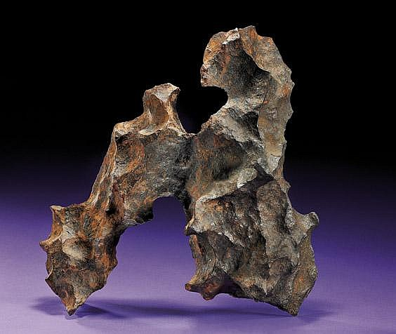 CANYON DIABLO METEORITE - AN EXTREMELY NOTABLE OFFERING: THE FINEST SCULPTURAL EXAMPLE OF THE QUINTESSENTIAL AMERICAN METEORITE