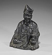 Chinese Bronze Model of a Seated Monk