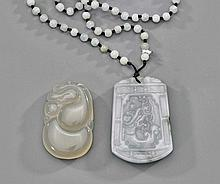 Two Chinese Carved Jadeite Pendants