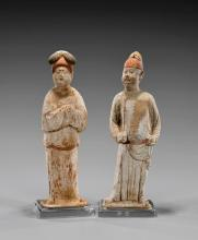 PAIR TANG DYNASTY POTTERY FIGURES