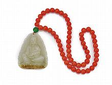 CARVED JADE PENDANT & CORAL BEADS