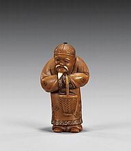OLD CARVED IVORY NETSUKE: Man with Basket