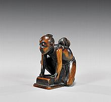 ANTIQUE CARVED WOOD NETSUKE: Rat Catcher