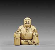 18TH CENTURY IVORY NETSUKE: Seated Man