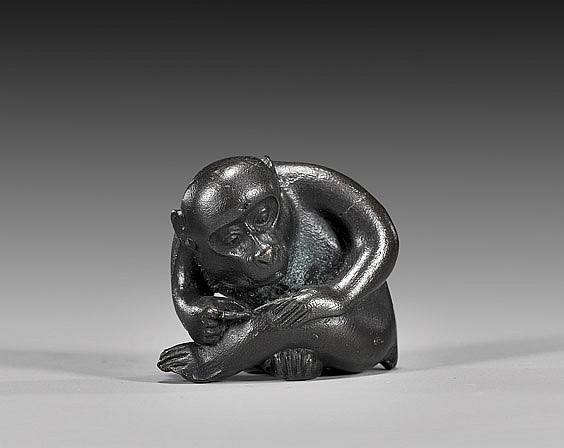 AMUSING BRONZE NETSUKE: Monkey