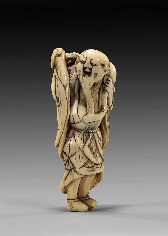 ANTIQUE IVORY NETSUKE: Sennin & Branch