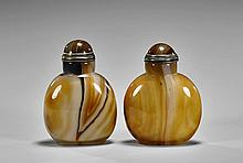 Two Carved Chalcedony Snuff Bottles
