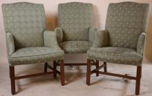 THREE UPHOLSTERED WING BACK ARMCHAIRS