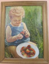 PORTRAIT OF A YOUNG CHILD EATING STRAWBERRIES