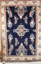 HAND WOVEN BLUE AND CREAM RUG